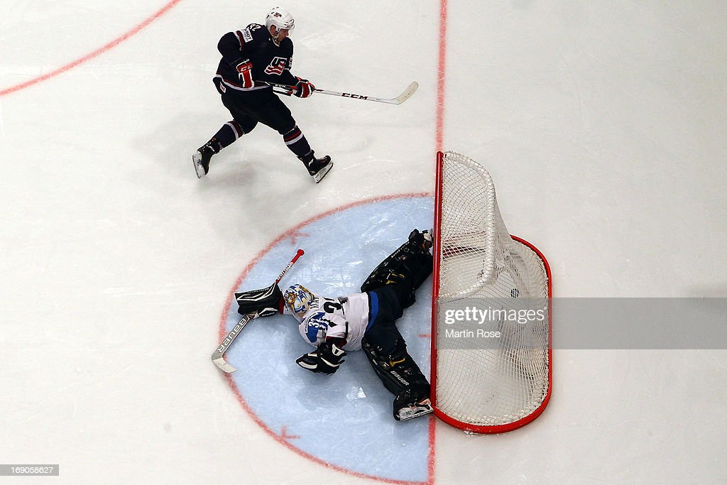 <a gi-track='captionPersonalityLinkClicked' href=/galleries/search?phrase=Alex+Galchenyuk&family=editorial&specificpeople=7419137 ng-click='$event.stopPropagation()'>Alex Galchenyuk</a> of USA scores his team's winning goal during penalty shut out during the IIHF World Championship third place match between Finland and USA at Globen Arena on May 19, 2013 in Stockholm, Sweden.