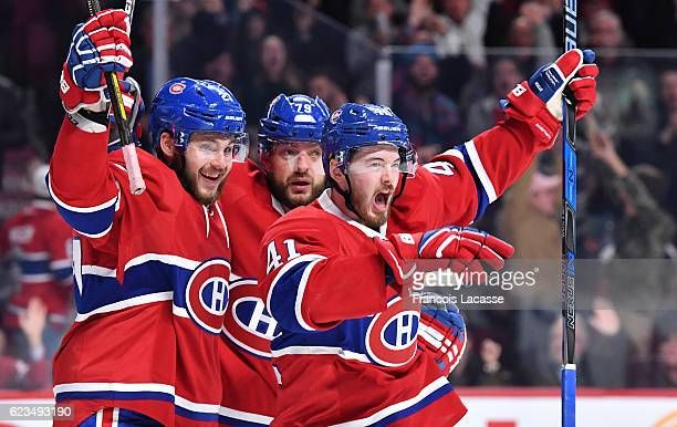 Alex Galchenyuk Paul Byron and Andrei Markov of the Montreal Canadiens celebrate a goal against the Florida Panthers in the NHL game at the Bell...