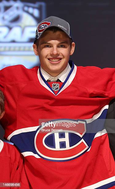 Alex Galchenyuk third overall pick by the Montreal Canadiens poses on stage during Round One of the 2012 NHL Entry Draft at Consol Energy Center on...