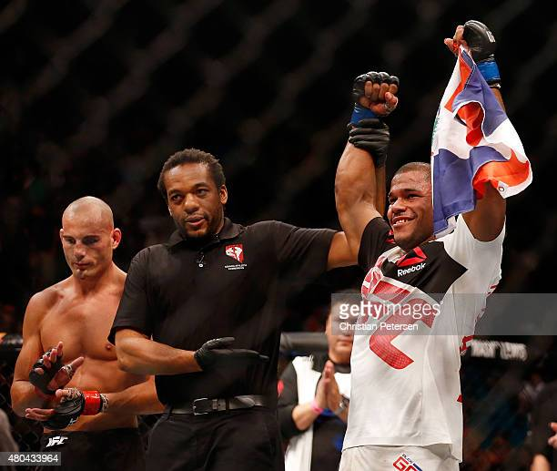 Alex Garcia celebrates after defeating Mike Swick in their welterweight fight during the UFC 189 event inside MGM Grand Garden Arena on July 11 2015...