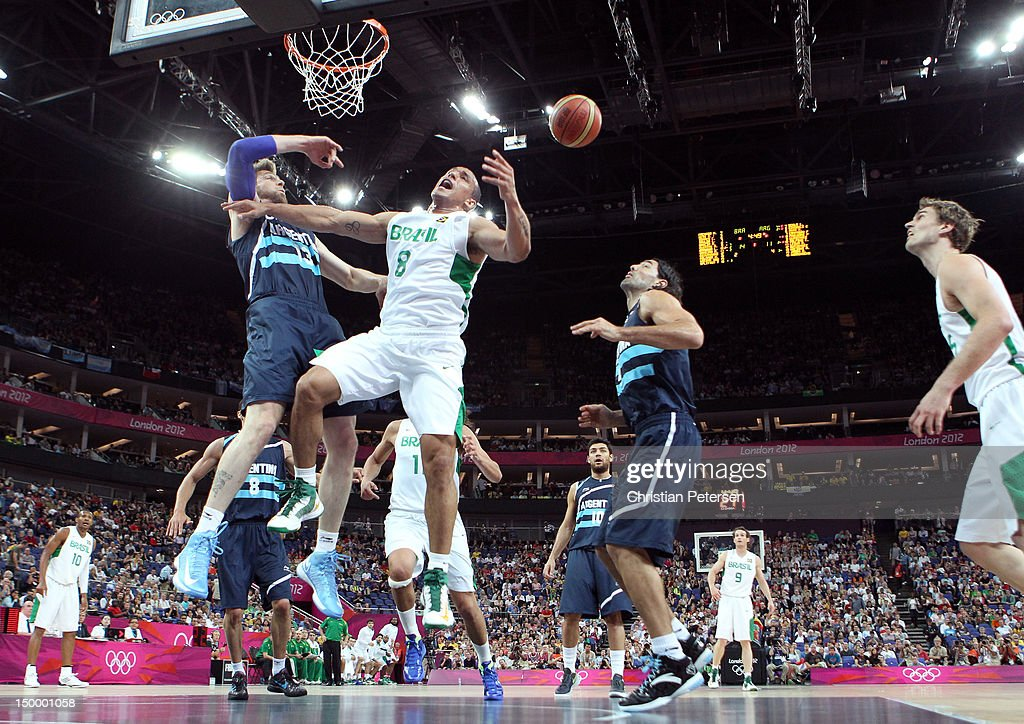 Alex Garcia #8 of Brazil goes up for a shot against Andres Nocioni #13 of Argentina in the first half during the Men's Basketball quaterfinal game on Day 12 of the London 2012 Olympic Games at North Greenwich Arena on August 8, 2012 in London, England.