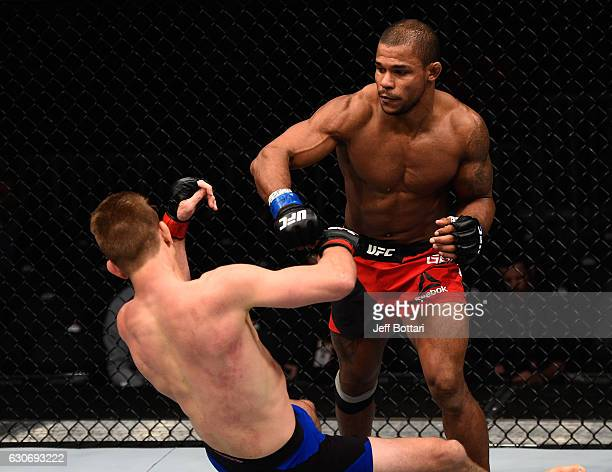 Alex Garcia of the Dominican Republic punches Mike Pyle in their welterweight bout during the UFC 207 event at TMobile Arena on December 30 2016 in...