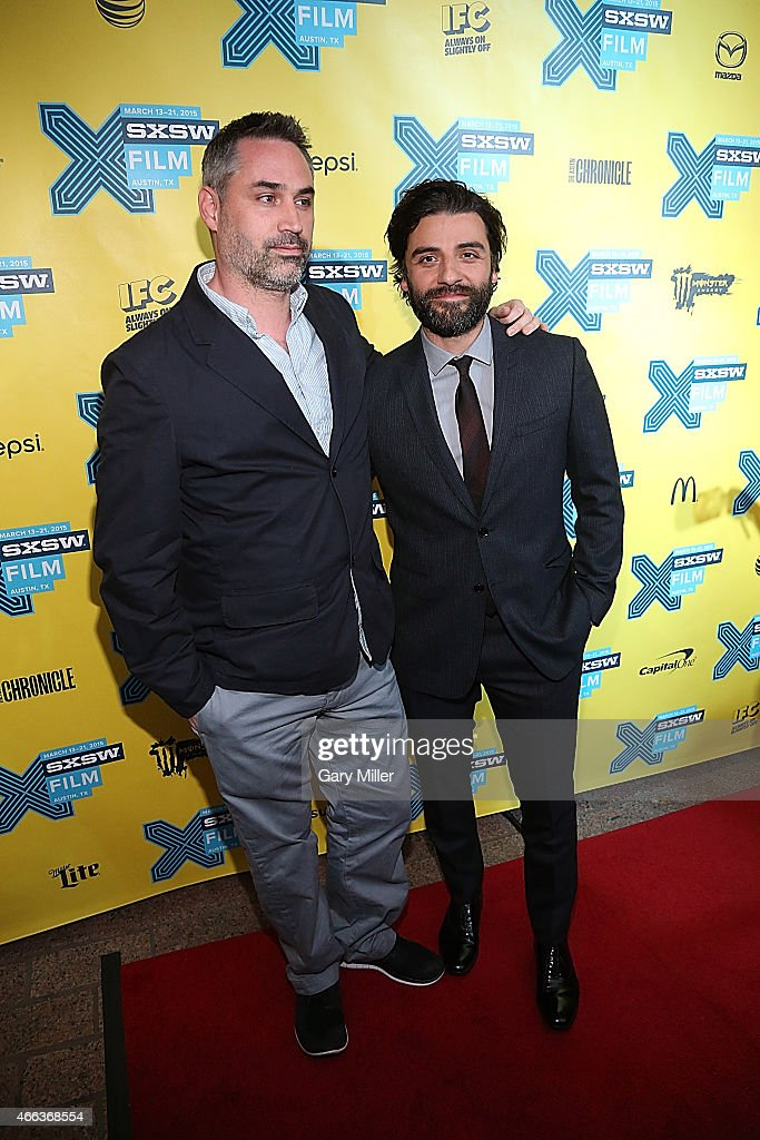 Alex Garland (L) and Oscar Isaac walk the red carpet at the premiere of 'Ex Machina' at the Paramount Theater during the South by Southwest Film Festival on March 14, 2015 in Austin, Texas.