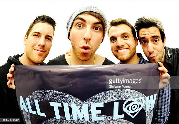 Alex Gaskarth Jack Barakat Rian Dawson and Zack Merrick of All Time Low pose backstage before performing and signing copies of their new album...