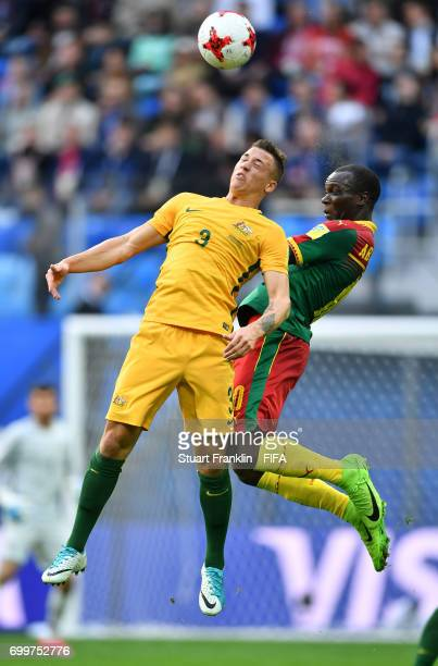 Alex Gersbach aof Australia and Vincent Aboubakar of Cameroon battle for possession during the FIFA Confederations Cup Russia 2017 Group B match...