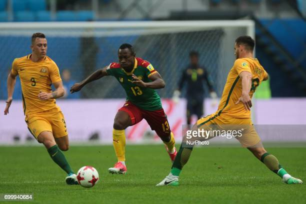 Alex Gersbach Bailey Wright of the Australia national football team and Christian Bassogog of the Cameroon national football team vie for the ball...