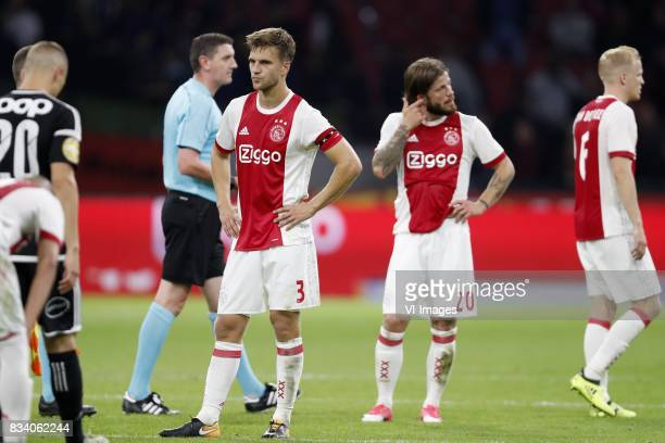 Alex Gersbach of Rosenborg BK referee Craig Thomson Joel Veltman of Ajax Lasse Schone of Ajax Donny van de Beek of Ajax during the UEFA Europa League...
