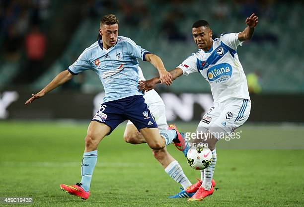 Alex Gersbach of Sydney FC competes for the ball against Rashid Mahazi of Melbourne Victory during the round six ALeague match between Sydney FC and...