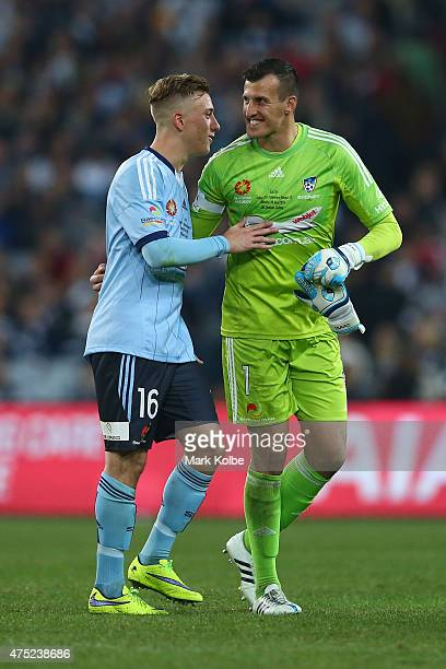 Alex Gersbach of Sydney FC embraces Ivan Necevski of Sydney FC as he leaves the field during the international friendly match between Sydney FC and...