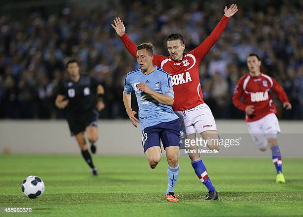 Alex Gersbach of Sydney is challenged by Mirjian Pavlovic of United during the FFA Cup match between Sydney United 58 FC and Sydney FC at Edensor...