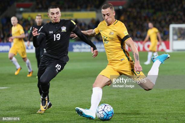 Alex Gersbach of the Socceroos kicks the ball past Tristan Do of Thailand during the 2018 FIFA World Cup Qualifier match between the Australian...