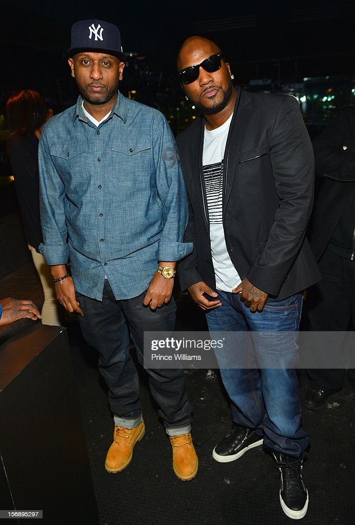 Alex Gidewon and Young Jeezy attend party hosted by LaLa at Reign Nightclub on November 23, 2012 in Atlanta, Georgia.