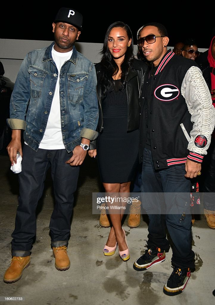 Alex Gidewon, Eudoxie Agnan and Ludacris attend a party at Compound on February 2, 2013 in Atlanta, Georgia.