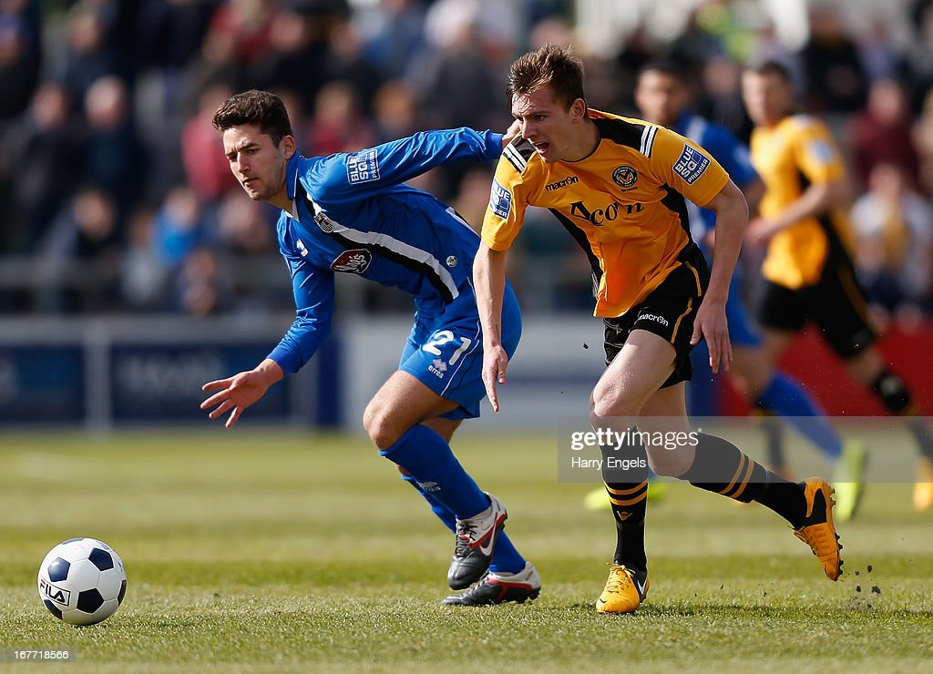 Alex Gilby of Newport County (R) and Andy Thanoj of Grimsby Town race for the ball during the Blue Square Bet Premier Conference Play-off second leg match between Newport County A.F.C. and Grimsby Town at Rodney Parade on April 28, 2013 in Newport, Wales.