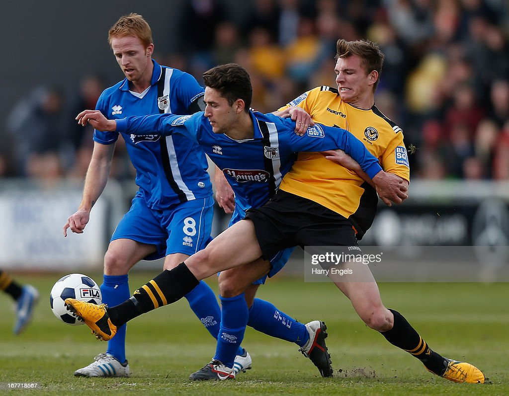 Alex Gilby of Newport County (R) tackles Andy Thanoj of Grimsby Town during the Blue Square Bet Premier Conference Play-off second leg match between Newport County A.F.C. and Grimsby Town at Rodney Parade on April 28, 2013 in Newport, Wales.