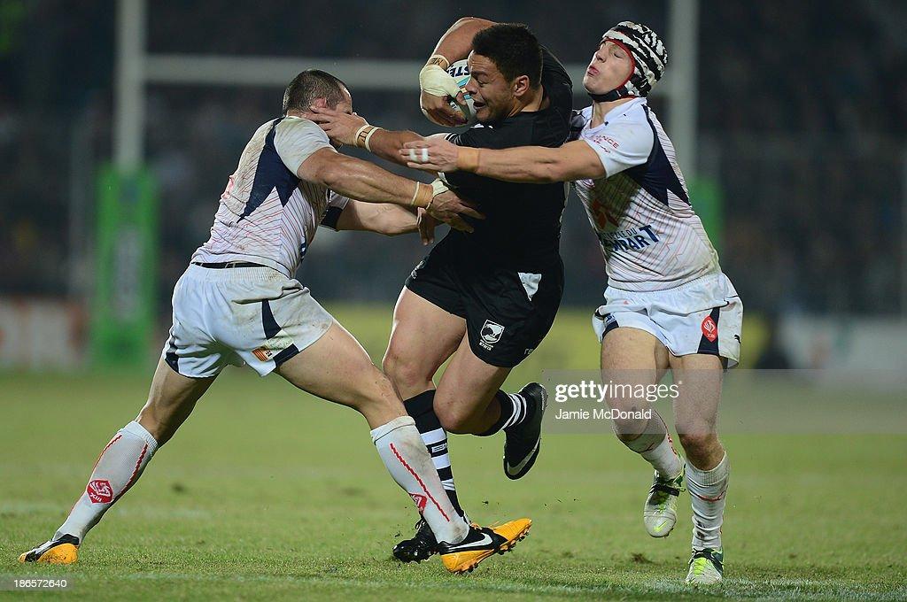 Alex Glenn of New Zealand slips the tackle of Theo Fages and Vincent Duport during the Rugby League World Cup group B match between New Zealand and France at Parc des Sports on November 1, 2013 in Avignon, France.