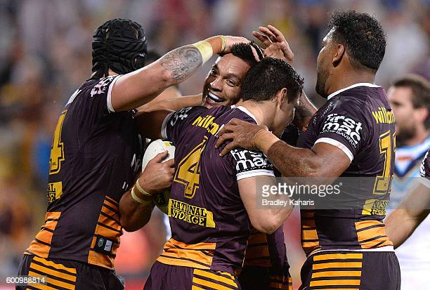 Alex Glenn of the Broncos is congratulated by team mates after scoring a try during the NRL Elimination Final match between the Brisbane Broncos and...