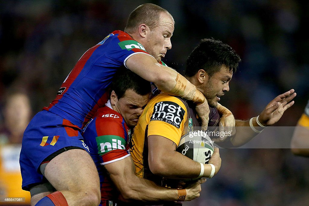 Alex Glenn of the Broncos is tackled by Jarrod Mullen and <a gi-track='captionPersonalityLinkClicked' href=/galleries/search?phrase=Beau+Scott&family=editorial&specificpeople=625951 ng-click='$event.stopPropagation()'>Beau Scott</a> of the Knights during the round seven NRL match between the Newcastle Knights and the Brisbane Broncos at Hunter Stadium on April 18, 2014 in Newcastle, Australia.