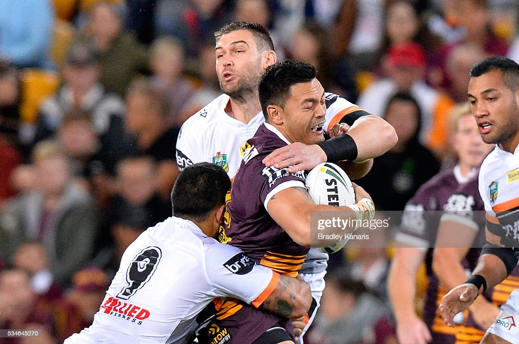 Alex Glenn of the Broncos is tackled during the round 12 NRL match between the Brisbane Broncos and the Wests Tigers at Suncorp Stadium on May 27, 2016 in Brisbane, Australia.