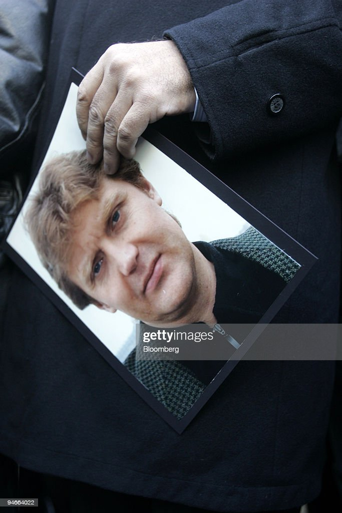 Alex Goldfarb holds a picture of <a gi-track='captionPersonalityLinkClicked' href=/galleries/search?phrase=Alexander+Litvinenko&family=editorial&specificpeople=2926201 ng-click='$event.stopPropagation()'>Alexander Litvinenko</a> as he talks to the press on the first anniversary of <a gi-track='captionPersonalityLinkClicked' href=/galleries/search?phrase=Alexander+Litvinenko&family=editorial&specificpeople=2926201 ng-click='$event.stopPropagation()'>Alexander Litvinenko</a>'s death, in London, U.K., on Friday, Nov. 23, 2007. The U.K. government has given up efforts to extradite the main suspect in the murder of former Russian intelligence operative Litvinenko for ``political reasons,'' exiled billionaire Boris Berezovsky said.