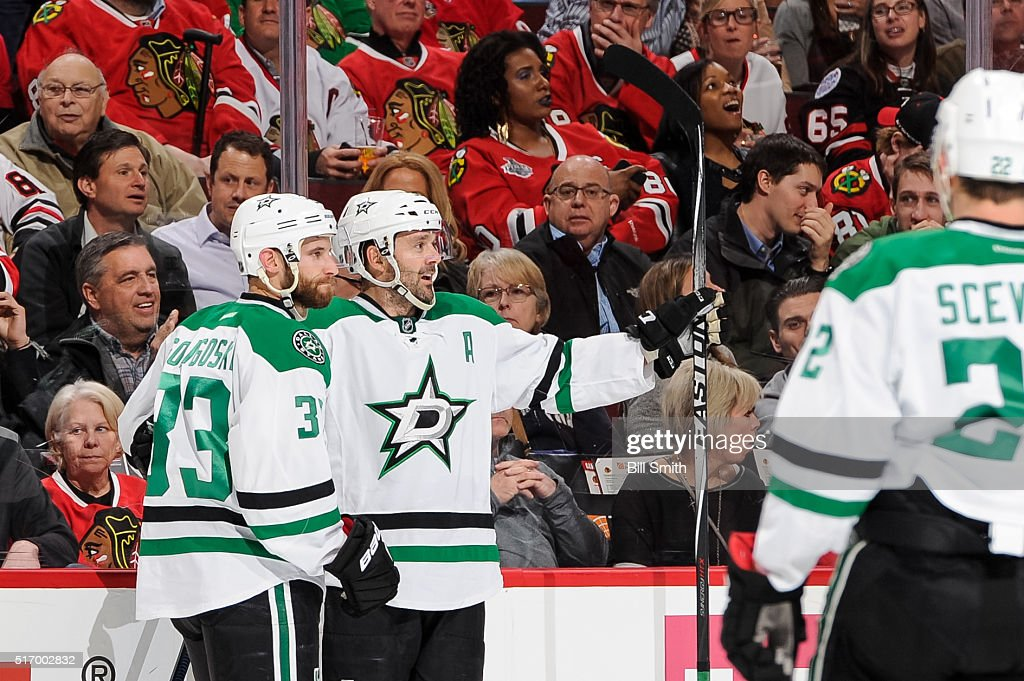 Alex Goligoski #33 and Vernon Fiddler #38 of the Dallas Stars celebrate after Fiddler scored his second goal in the first period of the NHL game against the Chicago Blackhawks at the United Center on March 22, 2016 in Chicago, Illinois.
