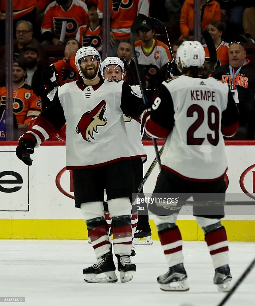 Alex Goligoski #33 of the Arizona Coyotes celebrates his game winning goal with teammate Mario Kempe #29 in the overtime period against the Philadelphia Flyers on October 30, 2017 at Wells Fargo Center in Philadelphia, Pennsylvania.The Arizona Coyotes defeated the Philadelphia Flyers 4-3 in overtime.