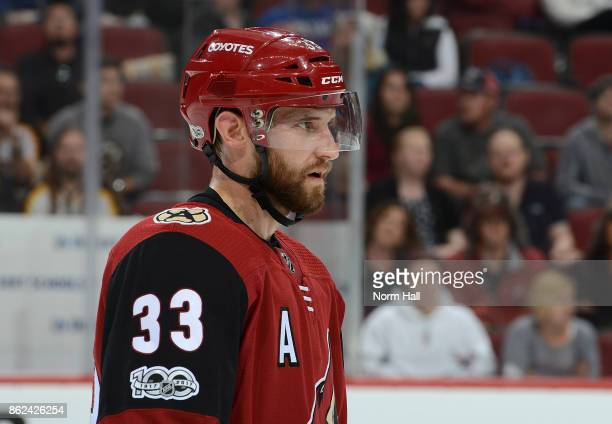 Alex Goligoski of the Arizona Coyotes gets ready during a faceoff against the Boston Bruins at Gila River Arena on October 14 2017 in Glendale Arizona
