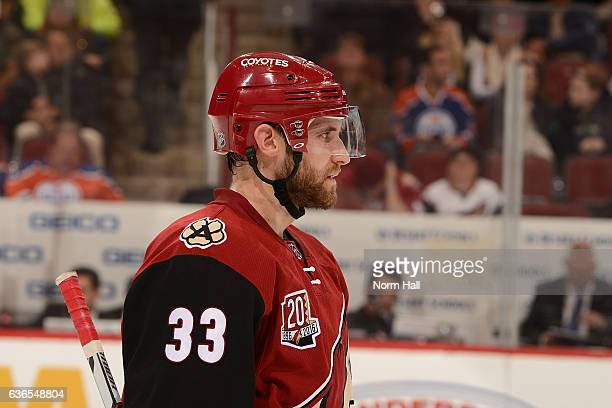 Alex Goligoski of the Arizona Coyotes looks up ice during a stop in play against the Edmonton Oilers at Gila River Arena on December 21 2016 in...