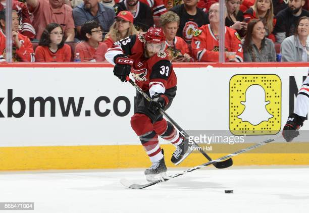 Alex Goligoski of the Arizona Coyotes passes the puck against the Chicago Blackhawks at Gila River Arena on October 21 2017 in Glendale Arizona