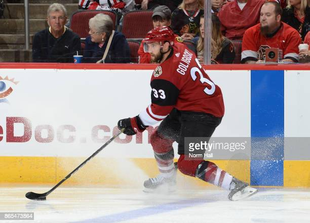Alex Goligoski of the Arizona Coyotes skates with the puck against the Chicago Blackhawks at Gila River Arena on October 21 2017 in Glendale Arizona