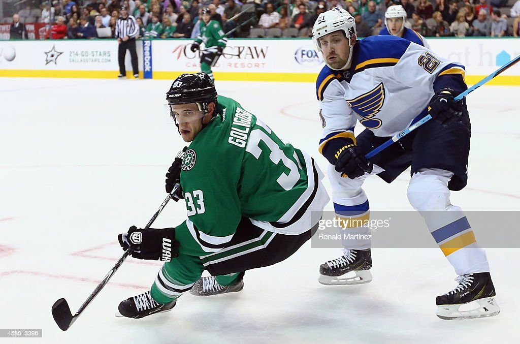Alex Goligoski of the Dallas Stars and Patrik Berglund of the St Louis Blues skate for the puck in the second period at American Airlines Center on...