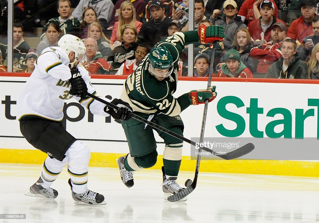 <a gi-track='captionPersonalityLinkClicked' href=/galleries/search?phrase=Alex+Goligoski&family=editorial&specificpeople=791866 ng-click='$event.stopPropagation()'>Alex Goligoski</a> #33 of the Dallas Stars blocks a shot by <a gi-track='captionPersonalityLinkClicked' href=/galleries/search?phrase=Cal+Clutterbuck&family=editorial&specificpeople=570497 ng-click='$event.stopPropagation()'>Cal Clutterbuck</a> #22 of the Minnesota Wild during the third period of the game on January 20, 2013 at Xcel Energy Center in St Paul, Minnesota. The Wild defeated the Stars 1-0.