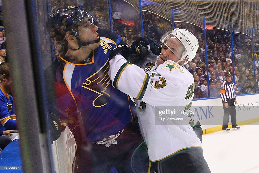 <a gi-track='captionPersonalityLinkClicked' href=/galleries/search?phrase=Alex+Goligoski&family=editorial&specificpeople=791866 ng-click='$event.stopPropagation()'>Alex Goligoski</a> #33 of the Dallas Stars checks <a gi-track='captionPersonalityLinkClicked' href=/galleries/search?phrase=Alexander+Steen&family=editorial&specificpeople=600136 ng-click='$event.stopPropagation()'>Alexander Steen</a> #20 into the boards during the third period at the Scottrade Center on April 19, 2013 in St. Louis, Missouri. The Blues beat the Stars 2-1.