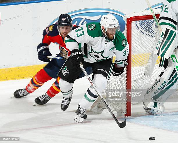Alex Goligoski of the Dallas Stars clears the puck from Quentin Howden of the Florida Panthers during third period action at the BBT Center on...