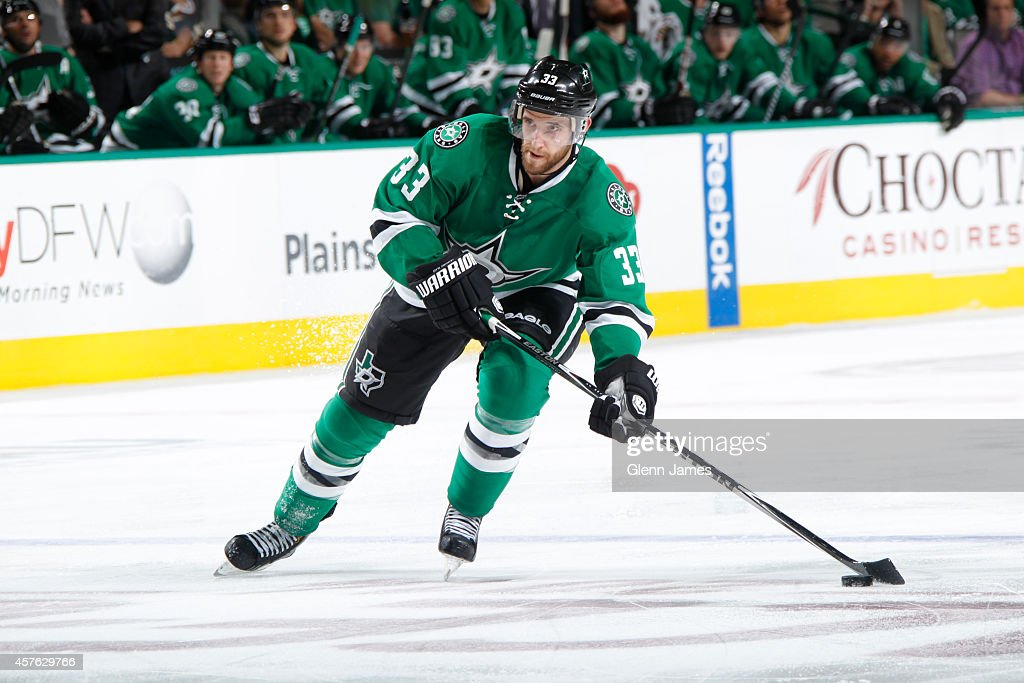Alex Goligoski of the Dallas Stars handles the puck against the Vancouver Canucks at the American Airlines Center on October 21 2014 in Dallas Texas