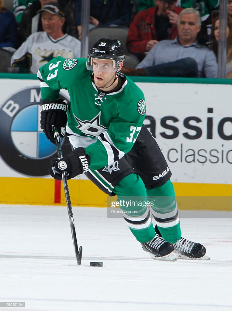 Alex Goligoski of the Dallas Stars handles the puck against the Anaheim Ducks at the American Airlines Center on October 31 2014 in Dallas Texas