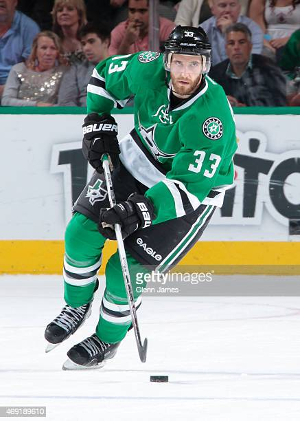 Alex Goligoski of the Dallas Stars handles the puck against the Calgary Flames at the American Airlines Center on March 30 2015 in Dallas Texas
