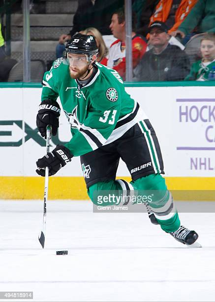 Alex Goligoski of the Dallas Stars handles the puck against the Florida Panthers at the American Airlines Center on October 24 2015 in Dallas Texas