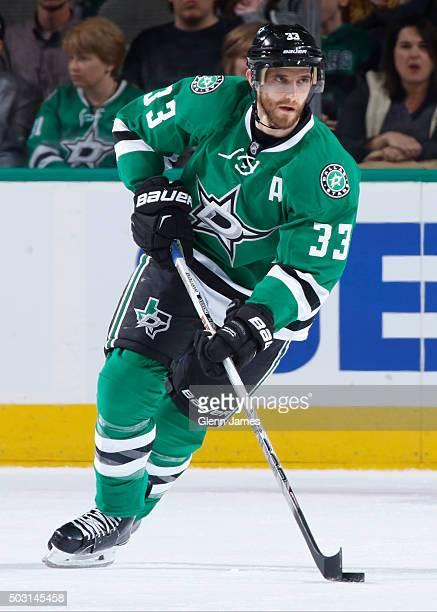 Alex Goligoski of the Dallas Stars handles the puck against the St Louis Blues at the American Airlines Center on December 27 2015 in Dallas Texas