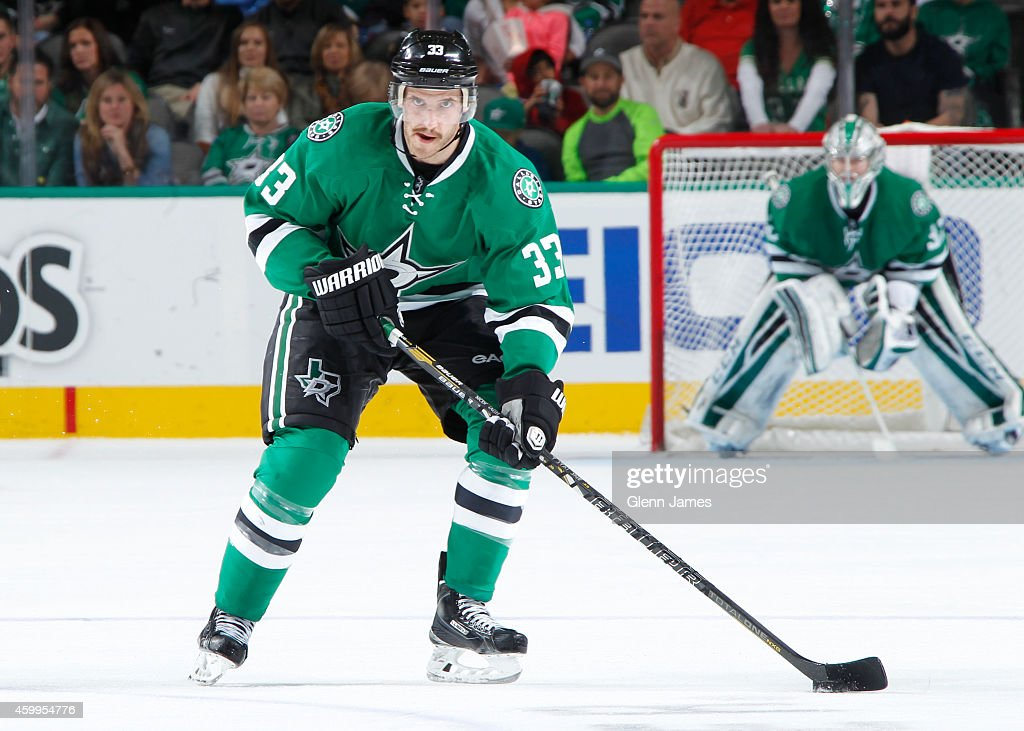 Alex Goligoski of the Dallas Stars handles the puck against the Minnesota Wild at the American Airlines Center on November 28 2014 in Dallas Texas