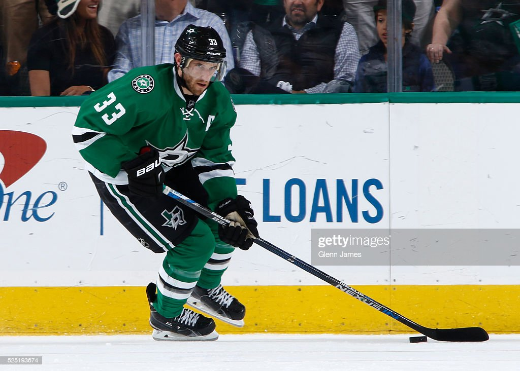 Alex Goligoski of the Dallas Stars handles the puck against the Minnesota Wild in Game Five of the Western Conference First Round during the 2016 NHL...