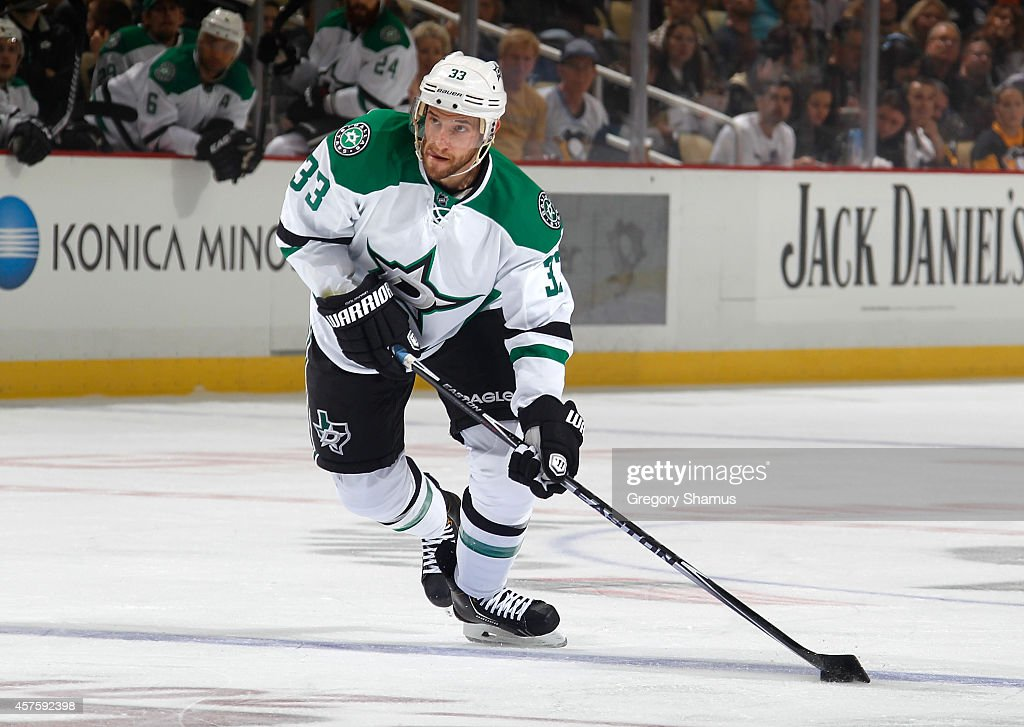 Alex Goligoski of the Dallas Stars moves the puck against the Pittsburgh Penguins at Consol Energy Center on October 16 2014 in Pittsburgh...