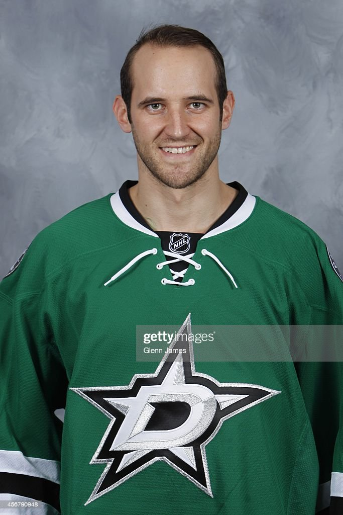 Alex Goligoski of the Dallas Stars poses for his official headshot for the 20142015 season on September 18 2014 at the American Airlines Center in...