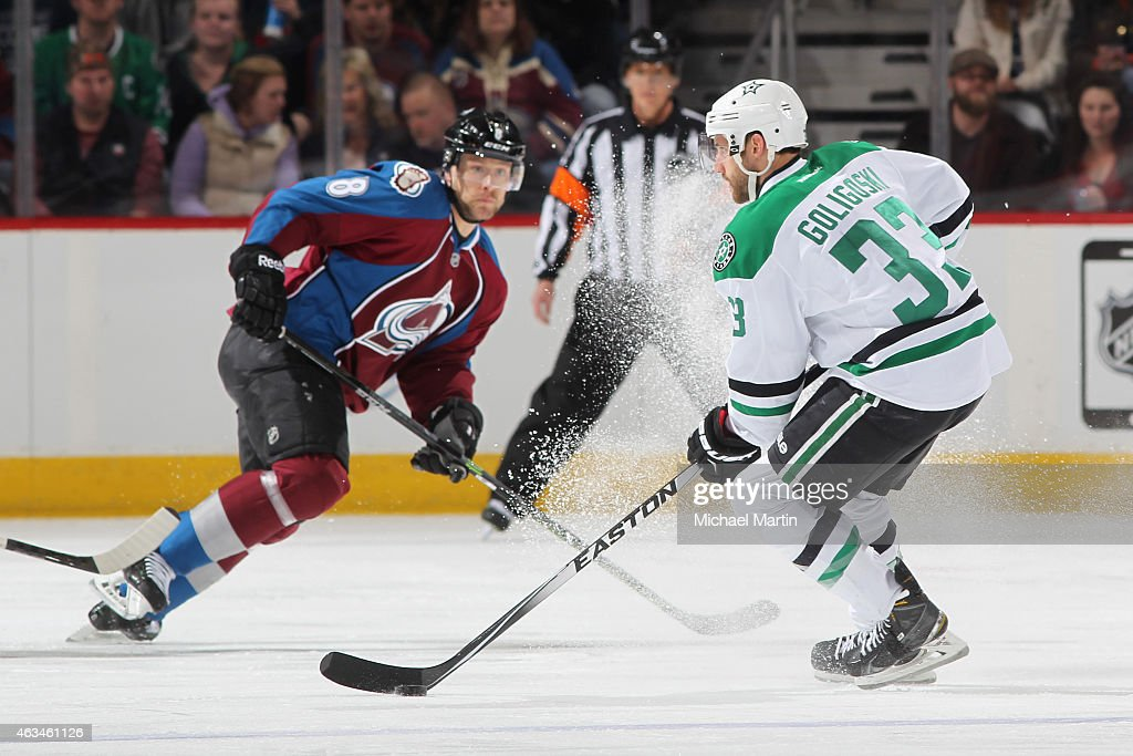 Alex Goligoski of the Dallas Stars puts on the breaks as Jan Hejda of the Colorado Avalanche closes in at the Pepsi Center on February 14 2015 in...