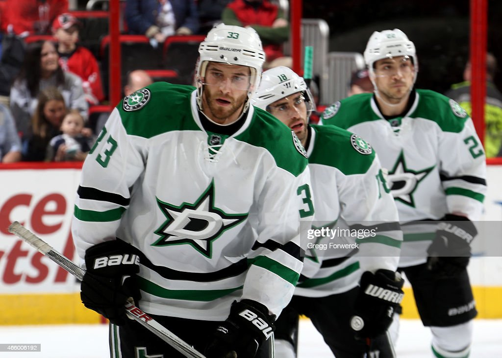 Alex Goligoski of the Dallas Stars skates back to the bench after his first period goal during an NHL game against of the Carolina Hurricanes at PNC...