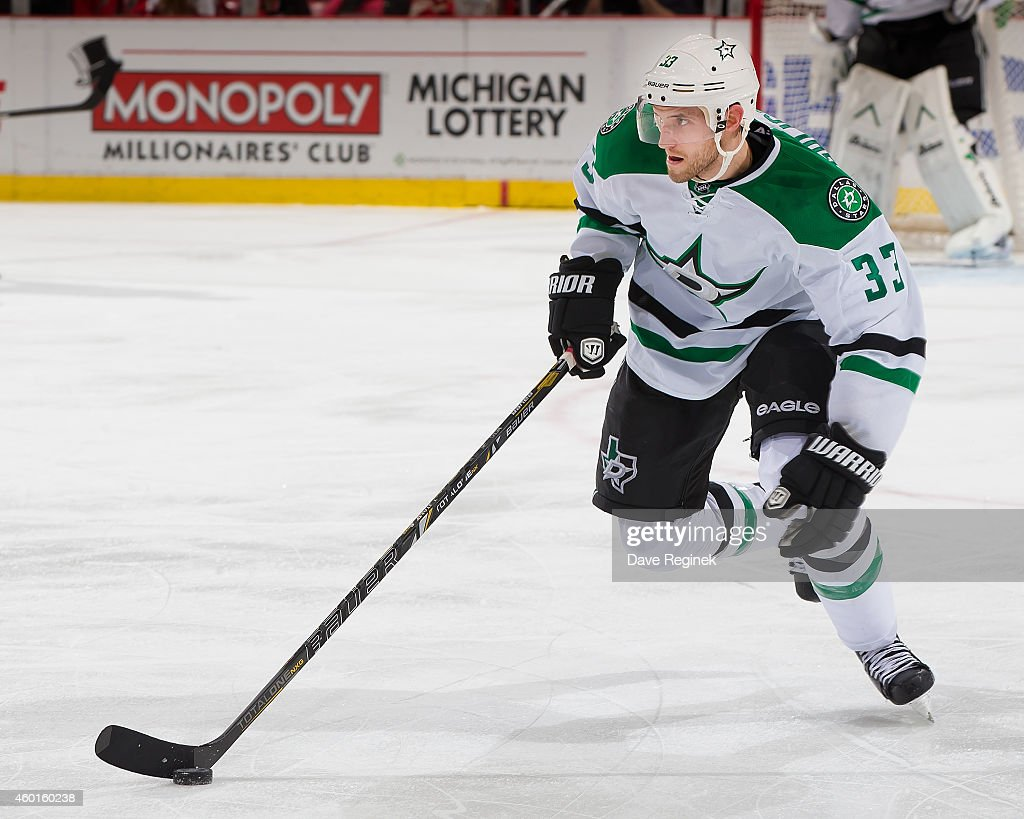 Alex Goligoski of the Dallas Stars skates up ice with the puck during a NHL game against the Detroit Red Wings on December 4 2014 at Joe Louis Arena...