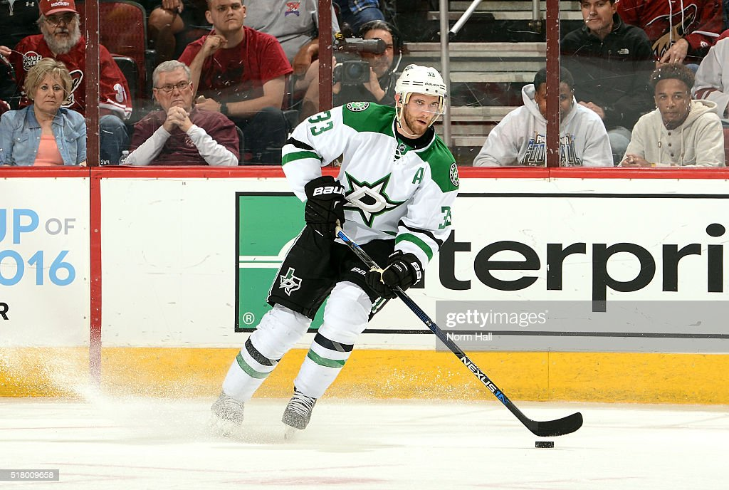 Alex Goligoski of the Dallas Stars skates with the puck against the Arizona Coyotes at Gila River Arena on March 24 2016 in Glendale Arizona