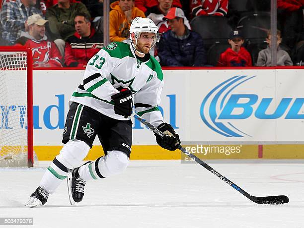 Alex Goligoski of the Dallas Stars takes the puck in the third period against the New Jersey Devils on January 22016 at Prudential Center in Newark...