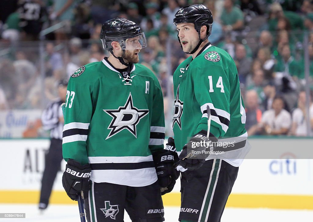 Alex Goligoski #33 of the Dallas Stars talks with Jamie Benn #14 of the Dallas Stars in the third period against the St. Louis Blues in Game Five of the Western Conference Second Round during the 2016 NHL Stanley Cup Playoffs at American Airlines Center on May 7, 2016 in Dallas, Texas.