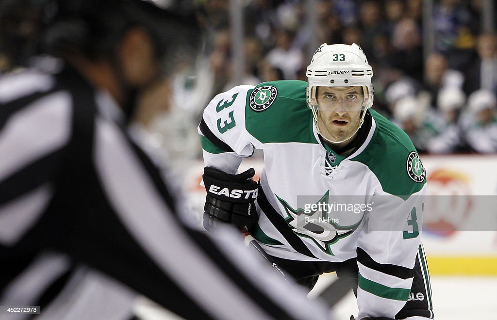 Alex Goligoski of the Dallas Stars waits for the puck to drop while playing the the Vancouver Canucks at Rogers Arena on November 17 2013 in...